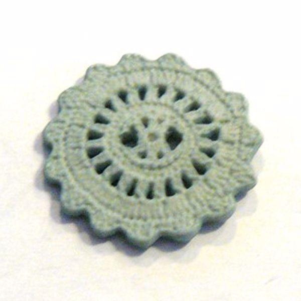 Flæse knap af mintgrøn plastic - 25 mm