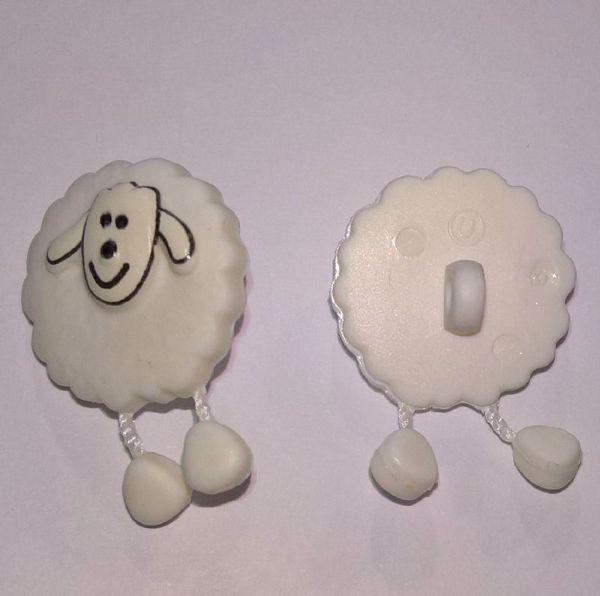 Hvid  fåreknap med dingle ben af plastic