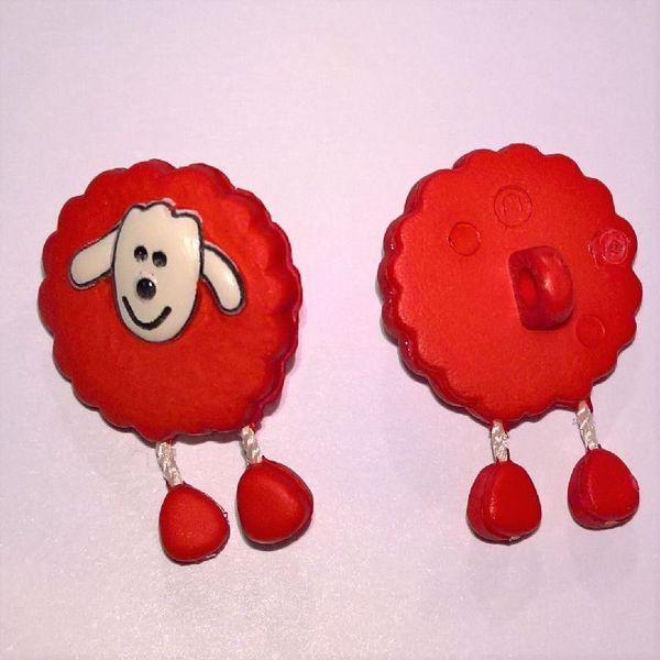 Rød fåreknap med dingle ben af plastic
