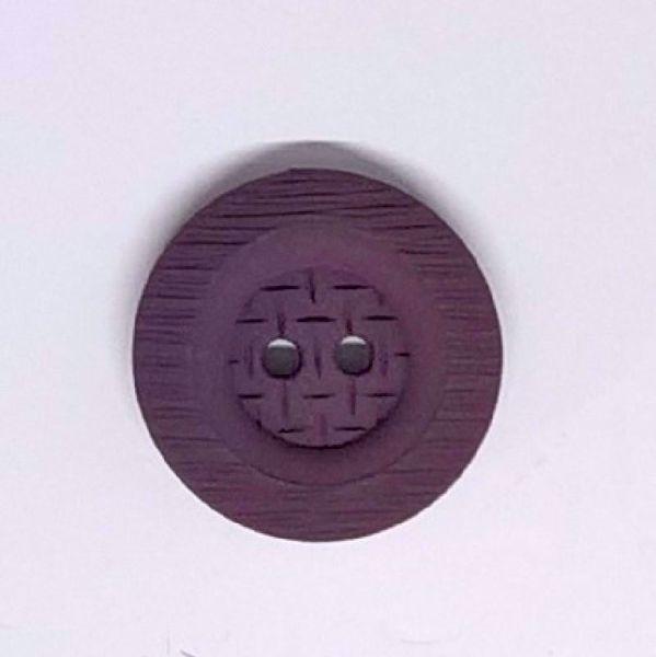 Struktureret plastik knap i en smuk mørk lilla